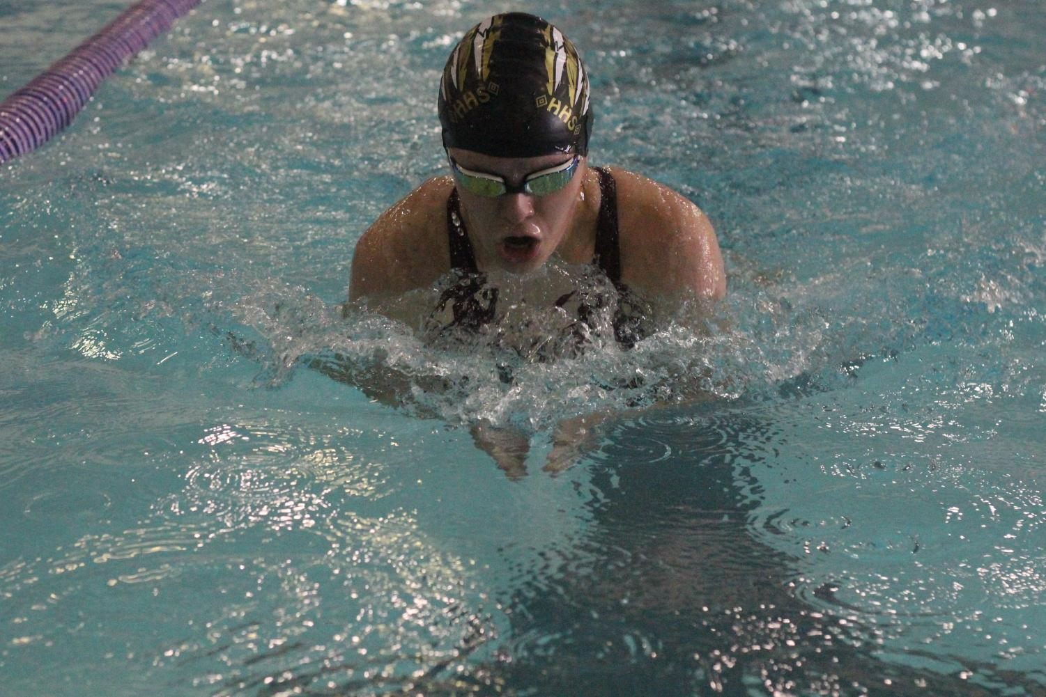 Sophomore Megan Flavin swimming the breastroke during her 200 IM. She placed 4th overall.