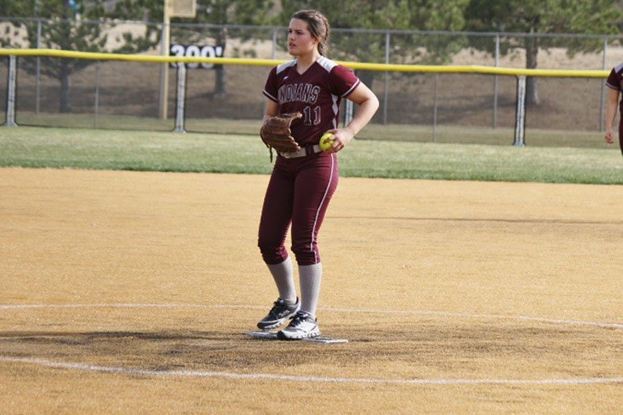 Junior Kaitlyn Brown starting her pitch at the Dodge City game on Apr. 5.