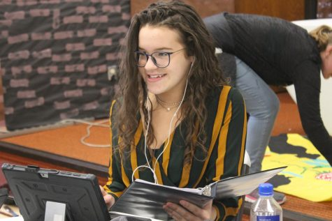 Junior Alex Indina practices for a forensics tournament.