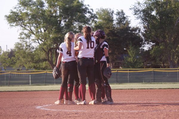 The Lady Indian infielders breaking it down, before the inning.