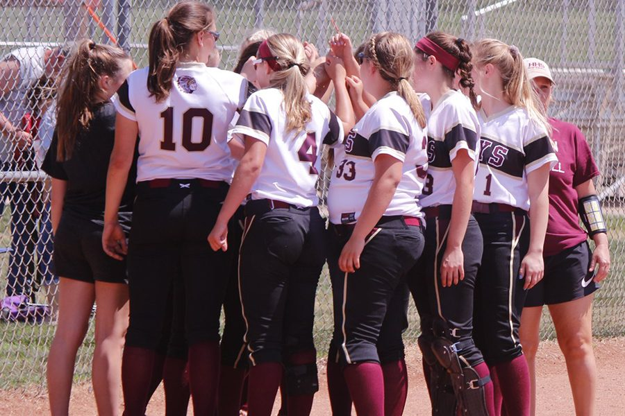 The+Indian+softball+team+breaking+it+down+before+their+game+vs+Andover+Central.+