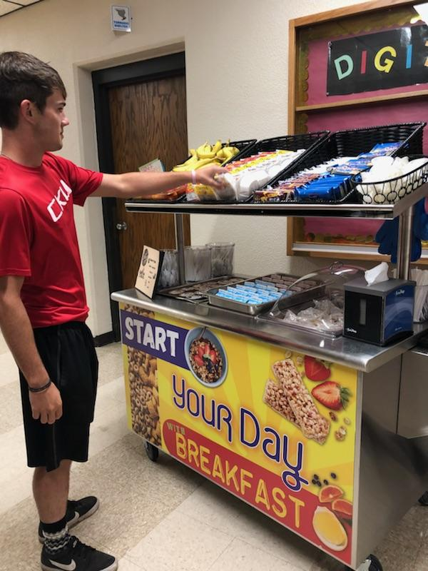 Senior Peyton Thorrel grabs breakfast from the Grab-and-Go Breakfast Cart before school. The cart runs 7:25 to 7:51 every morning.