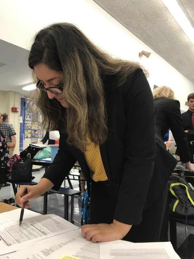 Junior Joanna Carrillo makes the final touches on her argument before she competes.
