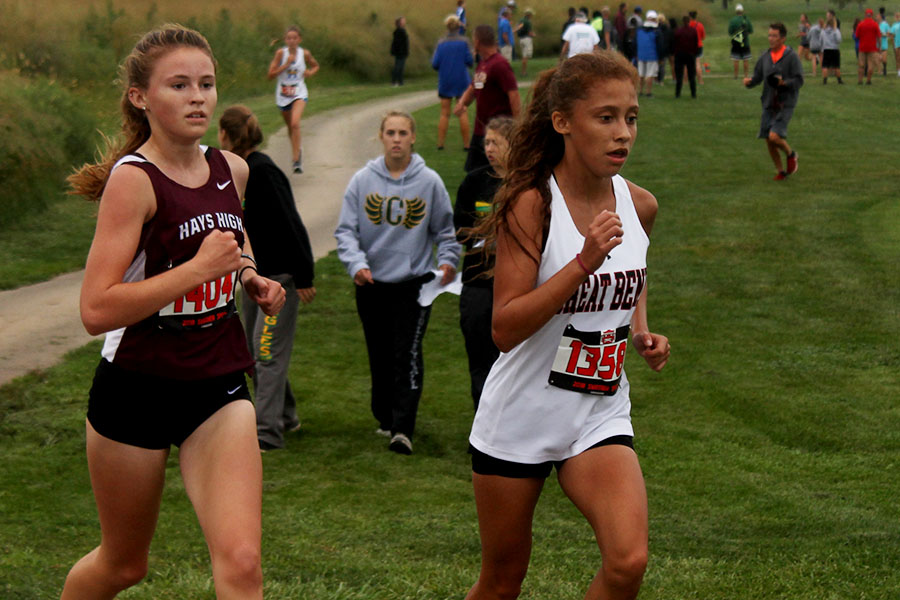 Freshman Landri Dotts battles against a Great Bend runner to the homestretch.