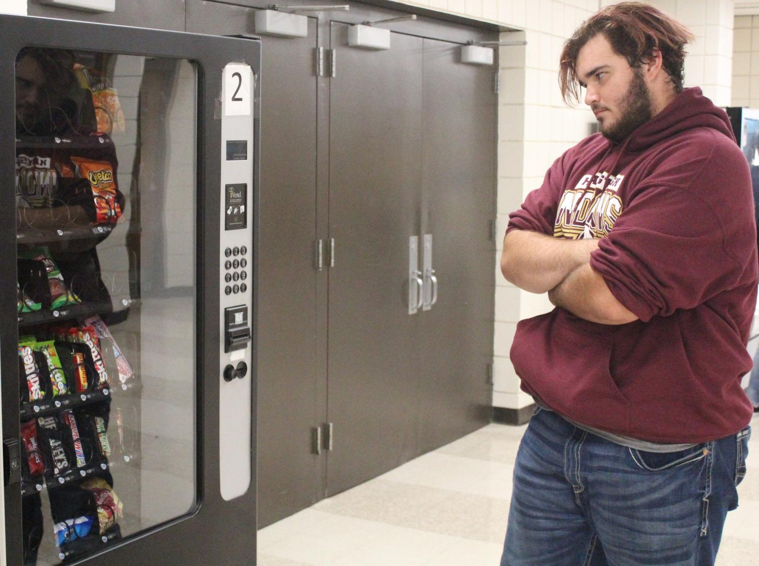 Student is frustrated with the new vending machine rule.
