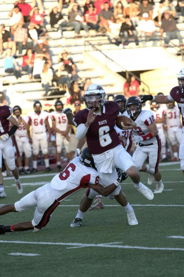 Senior Palmer Hutchison runs the ball on Friday Sept 14 against the Liberal Redskins. The Indians won 21-20.