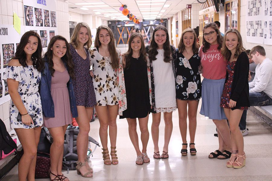 Senior+girls+pose+for+last+years+dress+up+day+during+Homecoming+week.