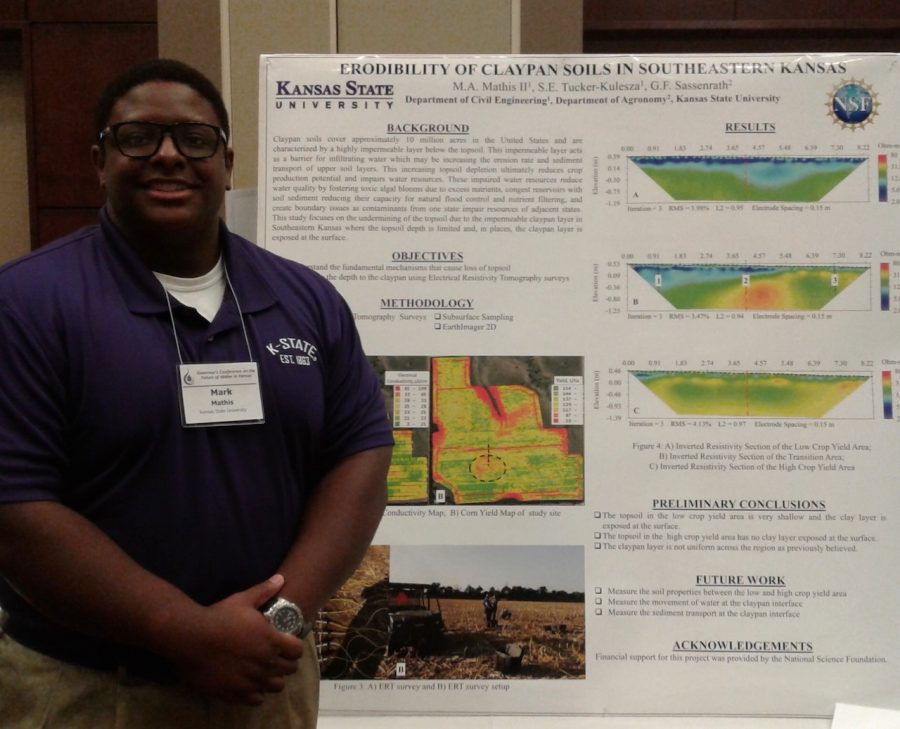 Mathis poses with his poster about Erodibility of claypan soils in Southeastern Kansas at the 2017 Governors Water Conference.