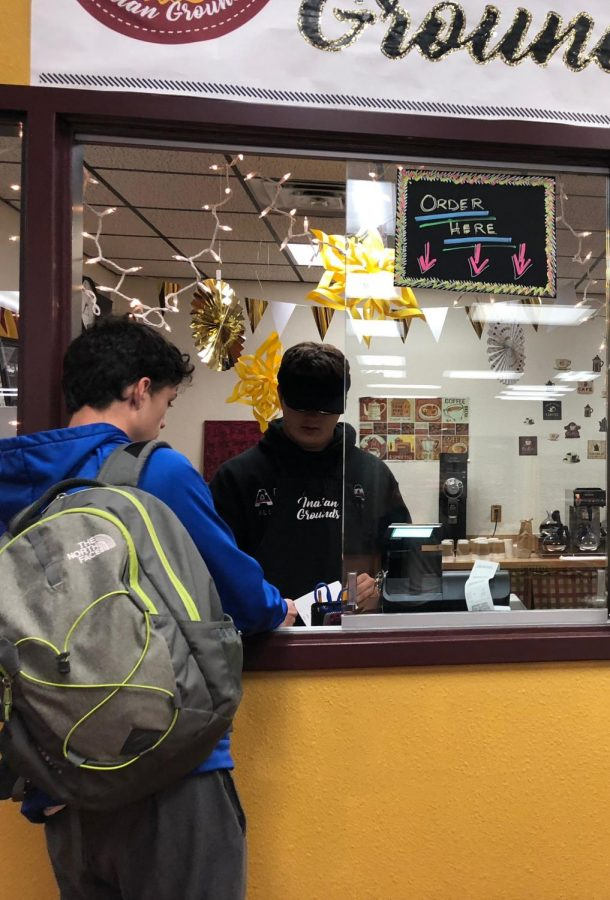 Senior Tanner Hastelhorst takes an order during operating hours. The coffee shop is open on Maroon days from 7:15 to 7:50 a.m.