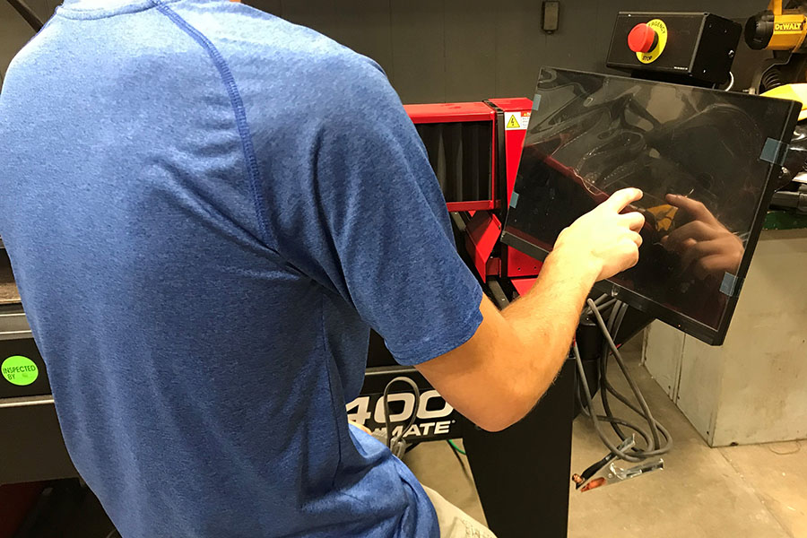Junior Marshall Meier prepares to use the new plasma cutter in the welding room.
