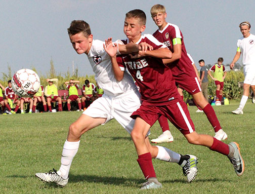 Freshman Chris Goodale fight for possession of the ball against Wichita Classical in a recent home match up. The Indians went on the win 4-2 in this match up.