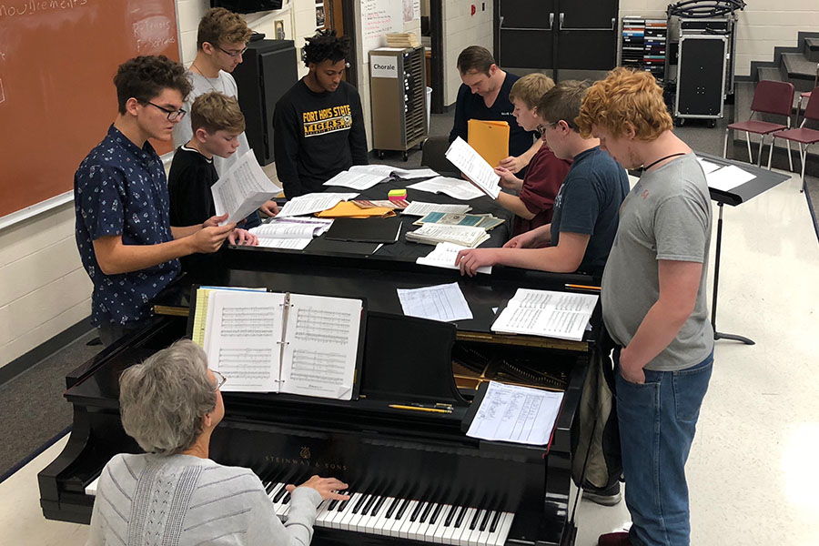 The tenors and basses rehearsing their District auditions with Alex Underwood during a seminar practice.