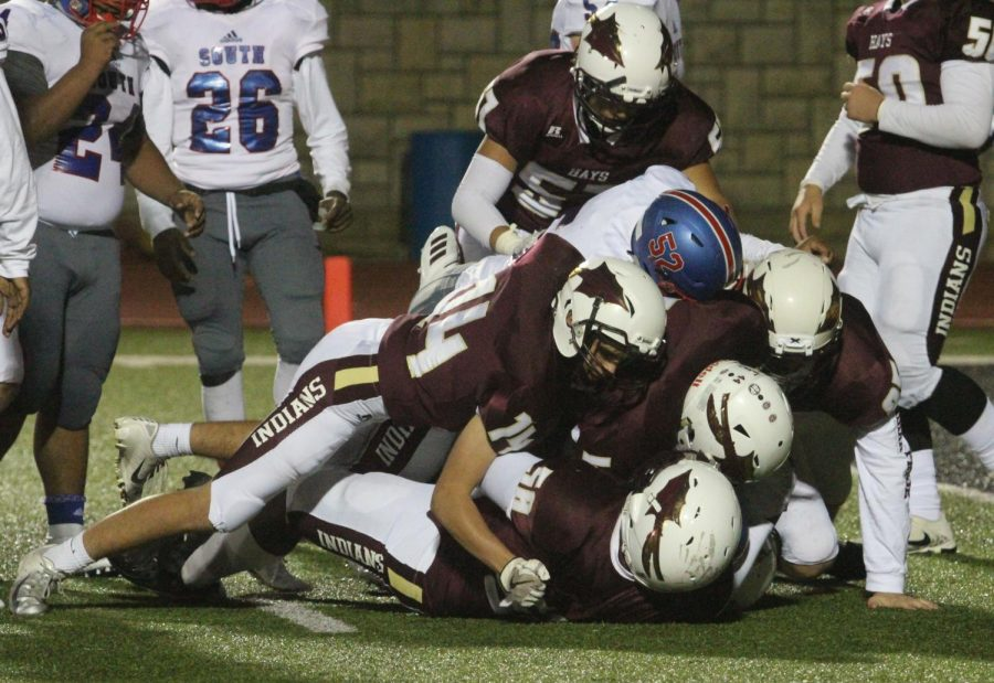 The Indians tackle the Titans in a recent game resulting in a victory.