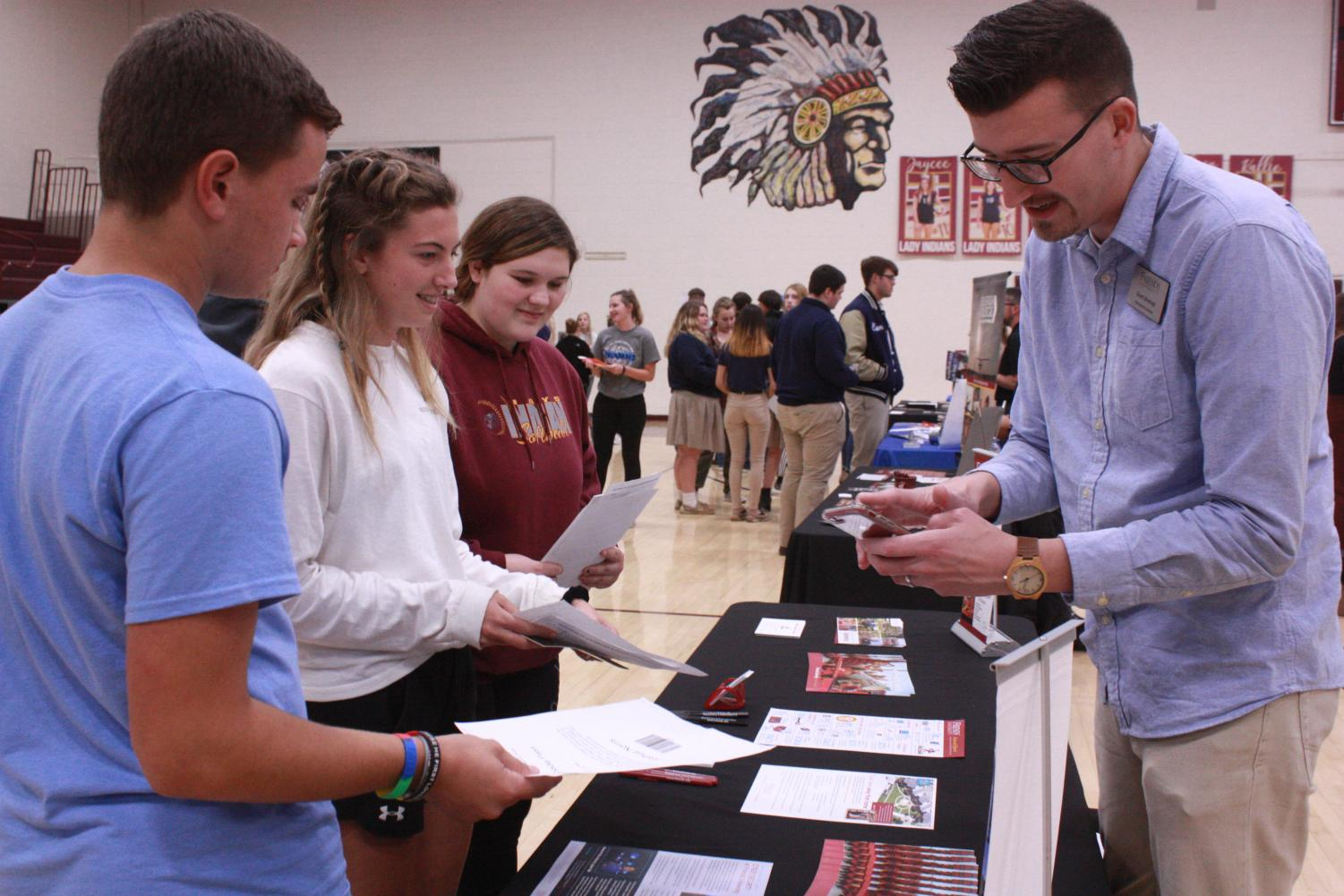 Senior Josh Norris and juniors Maddie Lohmeyer and Kallyn Petz took the College Planning Conference as an opportunity to approach colleges and ask questions.
