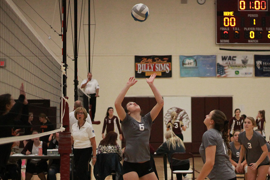 Senior Hannah McGuire setting up senior Jaycee Dale at the recent home game against Larned.