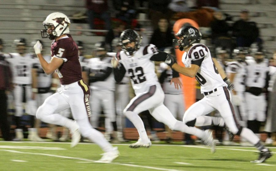 Junior Hayden Brown runs for a touchdown in a recent game against Buhler. On October 19, the Indians fell short to the Salina Central Mustangs.