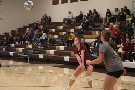 Senior Kallie Leiker, setting up a pass at home against Larned.
