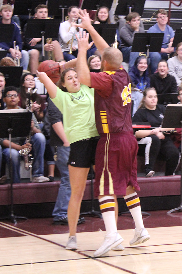 Instructor Dustin Dreher attempts to block Jaysa Wichers's shot.