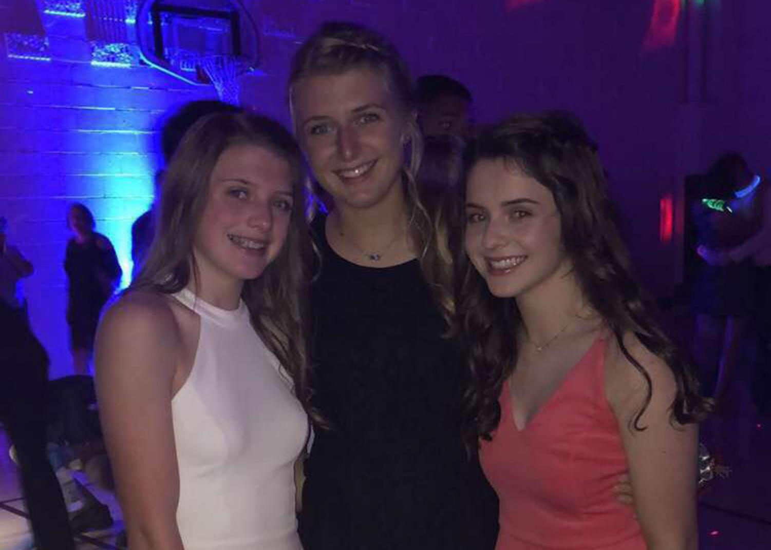 The Robben sisters (left to right) freshman Caroline, junior Isabel and sophomore Maggie go to their first of many high school dances together.