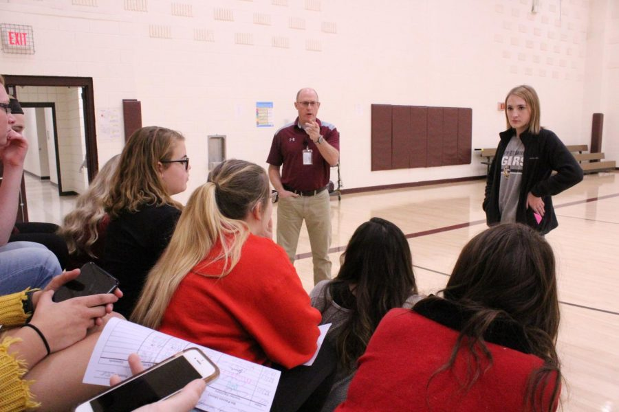Several girls sit in Gym B while the dance team coach gives information about the new dance team. The meeting was held on Dec. 18.