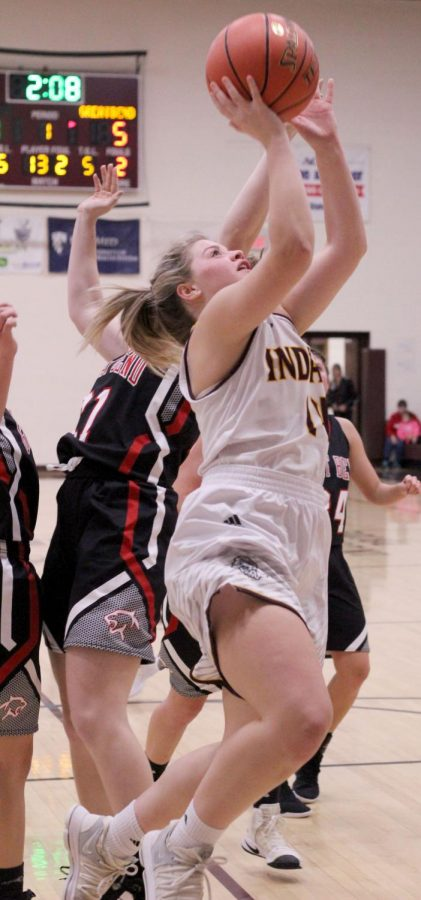 Senior Mattie Hutchinson goes up for a lay-up at the Hays City Shootout against Great Bend.