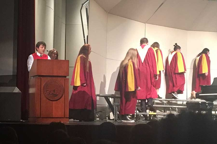 Doug Drabkin reads a few poems during a transition between Chamber Singers and Concert Choir.