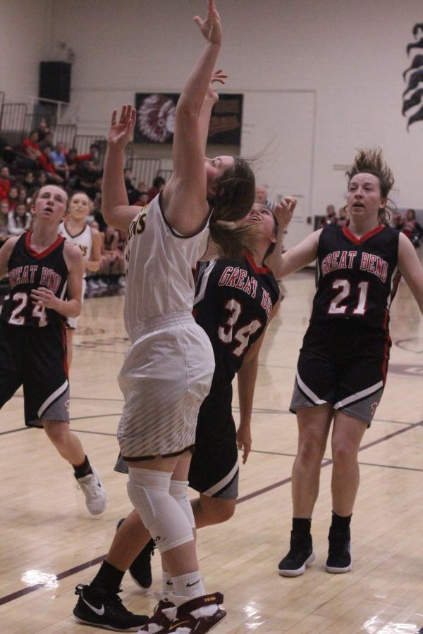 Junior Brooke Denning attempts a basket at a previous game against Colby. The Lady Indians recently won the Colby Invitational which makes their record 8-3 for the season.