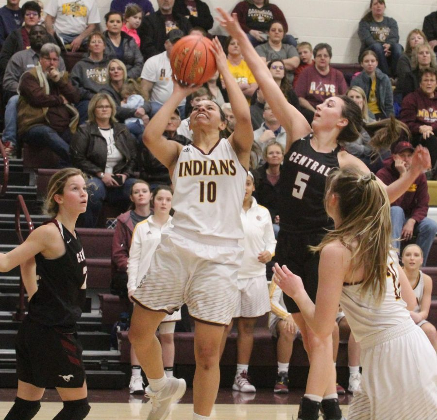 Junior Tasiah Nunnery attempts a basket at the home game against Salina Central. Hays won 73-65.