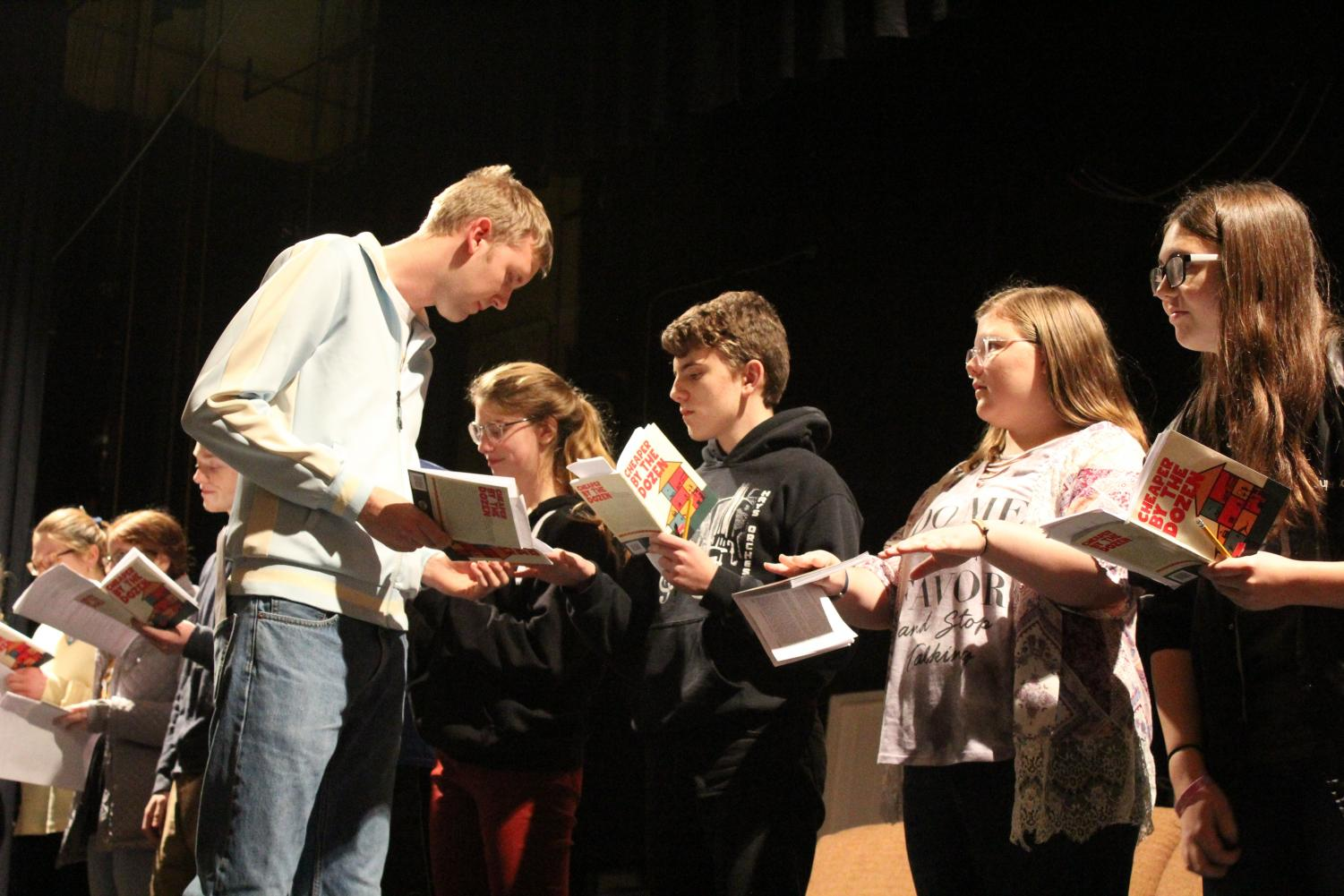 Mr. Gilbreth, played by senior Calvin Duden, lectures his children.