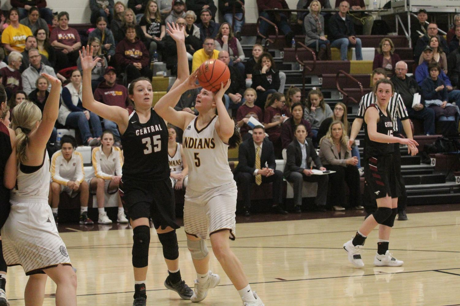 Senior Jaycee Dale attempts a basket at a previous home game. The team is now 13-7 and will play at home on Feb. 27 for Sub-State.