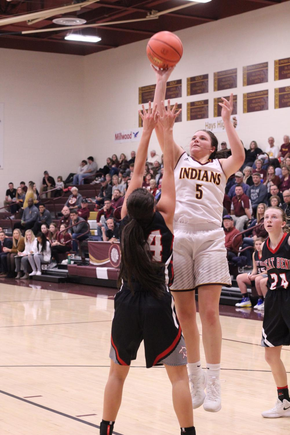 Senior Jaycee Dale attempts a basket at previous game against Great Bend. The Indians are now 12-4 and will play Liberal at home on Feb. 8.