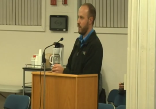 Technology Director Scott Summers answers questions concerning the different technology options for the middle school next year. A decision will be reached on the March 25 board meeting.