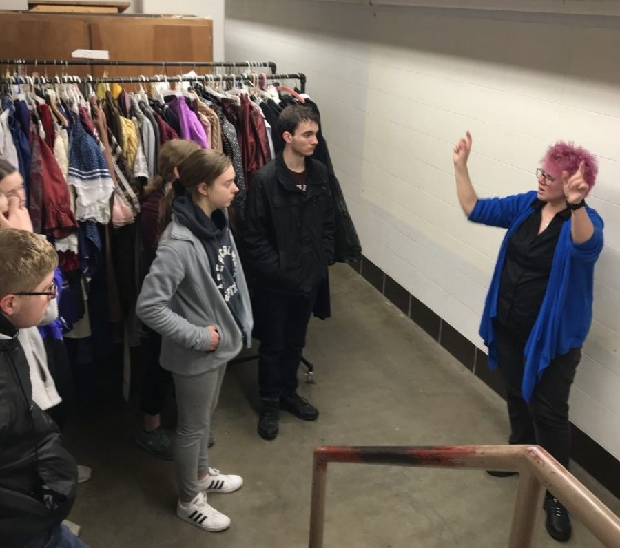 """Fort Hays State University technical director Debra Holmes gives students tour of Felten Theatre. Students were also able to watch the play play """"Barefoot in the Park""""."""