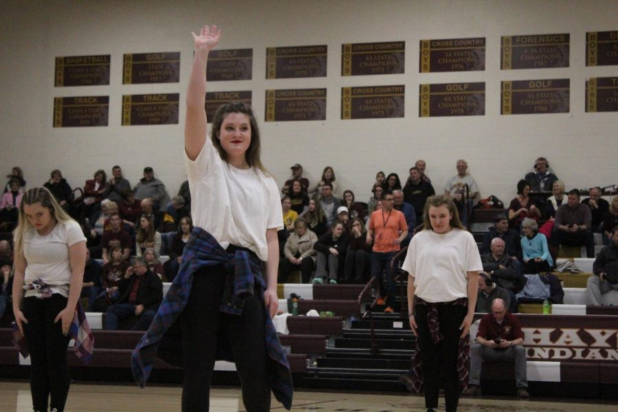 During last season's senior night, senior Payton Selby waves to the crowd. Dance team auditions for the 2019-2020 school year took place on Thursday, Mar. 21.