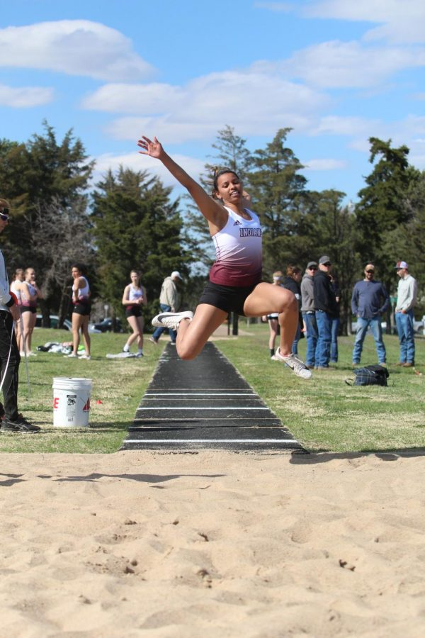 Junior+Tasiah+Nunnery+triple+jumps+at+a+track+meet+in+Larned.+Recently%2C+girls+track+took+first+at+Abilene.