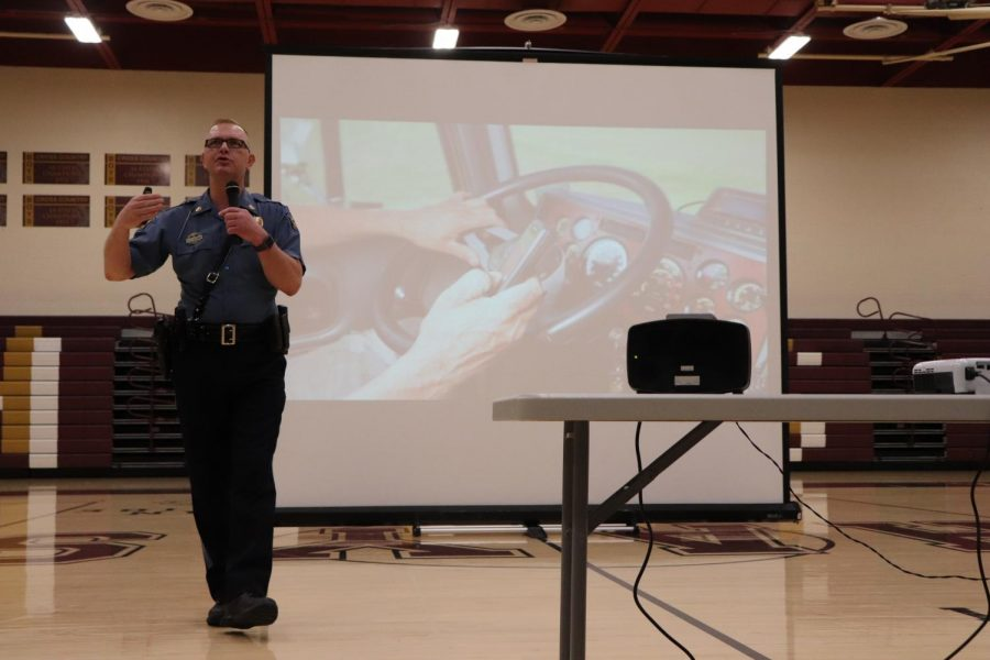 State+Trooper+Tod+Hileman+discusses+the+dangers+of+distracted+driving.+Distractions+include%3A+changing+radio+stations%2C+talking+to+passengers%2C+texting+or+using+your+phone+and+tiredness.+Hileman+urged+students+to+focus+on+their+driving+and+not+drive+distractedly+because+in+some+cases+it+could+be+the+difference+between+life+and+death.+