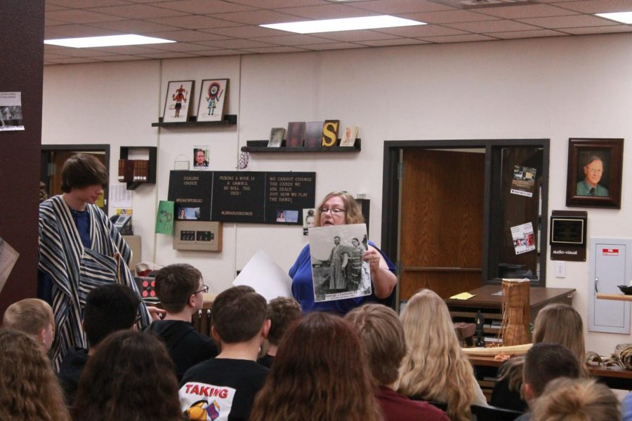 Folkerts shows the students a picture of her grandparents while they were in Liberia.