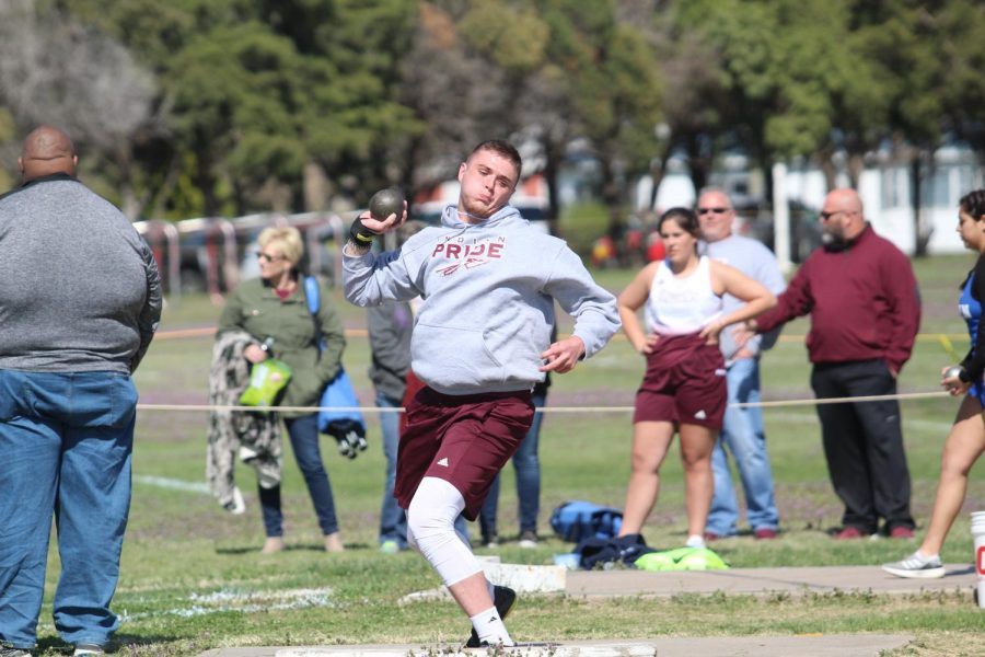 Senior Chase Brous gets ready to throw a shot put at a track meet held in Larned. The track team placed second at the Great Bend Varsity Invitational.