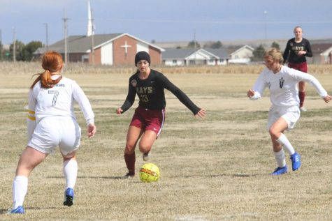 Senior Kallie Leiker dribbles a ball at a previous home game against TMP. The Lady Indian soccer season ended after a 2-1 loss against Valley Center on May 16.