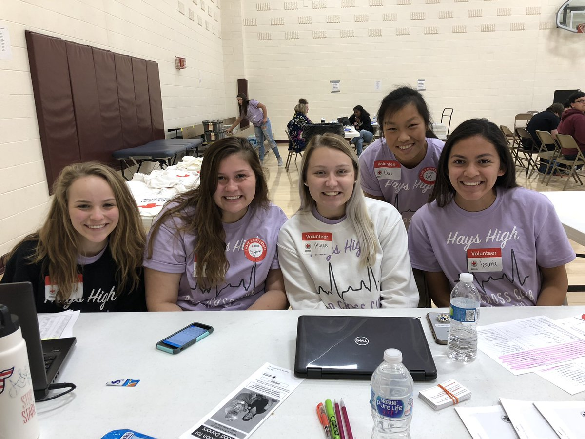 2018-2019 Red Cross Club Officers pose for a picture during a blood drive.  As a Red Cross Club officer, students are required to supervise all  blood drives that take place.