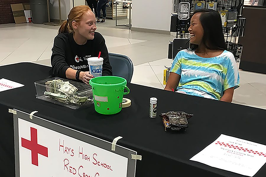 Red Cross Club members Lynsie Hansen and Cori Isbell collect donations at the mall. Cori Isbell was the Red Cross Club