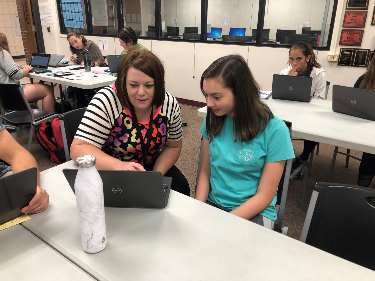 Junior Alicia Feyerherm shows her PRIDE time instructor Jessica Augustine what she's working on.