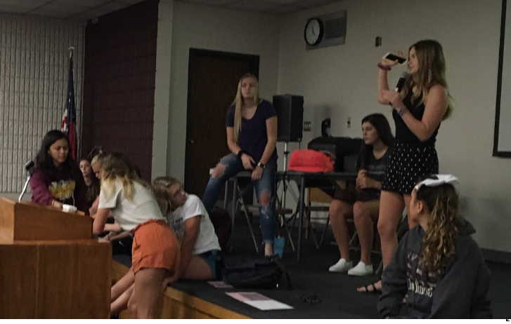StuCo Public Relations Officer Kaylor Meyers addresses StuCo during the meeting on Aug. 28. Members signed into the meeting via Kahoot. For those with technological difficulties, a paper attendance sheet was passed around the Lecture Hall.