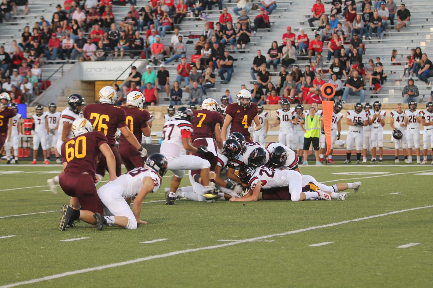 The Indian offense runs a play against the Panthers during the game on the 13th.
