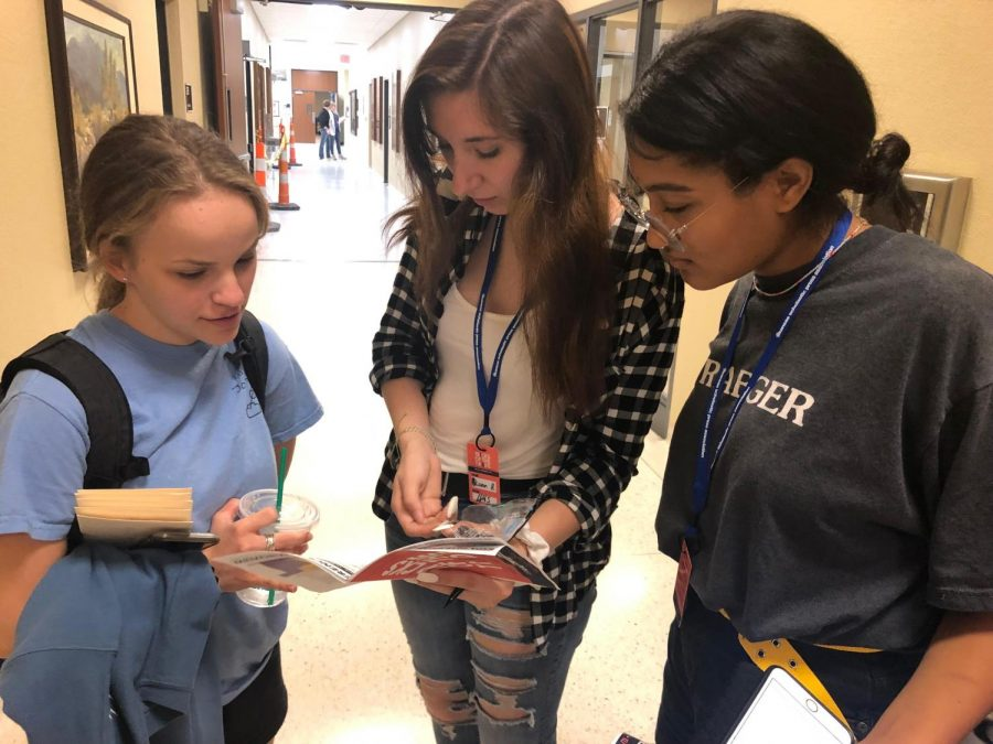 Seniors Allison Hillebrand, Paige Polifka-Denson and former student Isabelle Braun decide which of the individual skill sessions to attend. Interviewing, creating deadline strategies, and layout and design were just a few of the many topics covered.