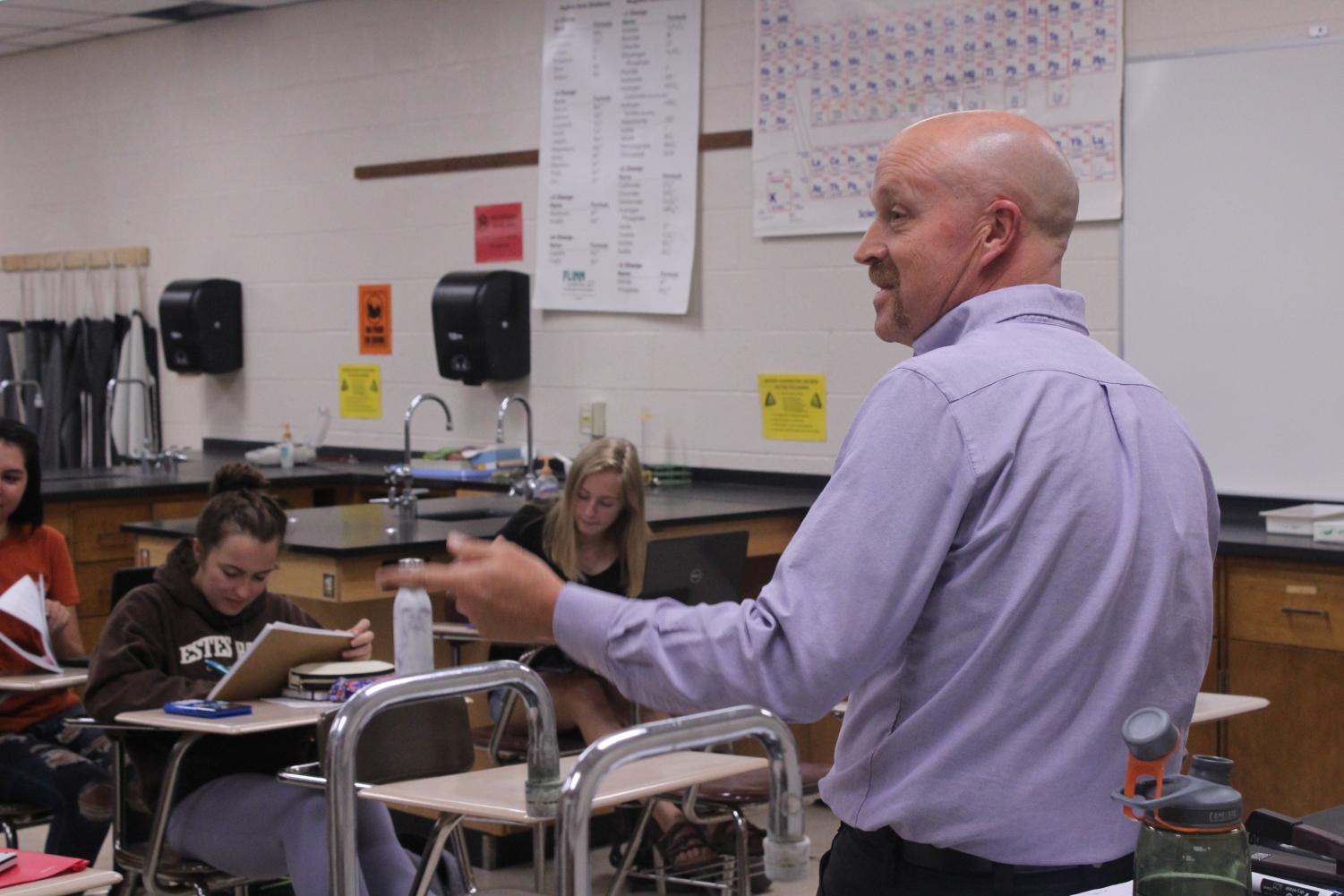 Instructor Alan Neal gives directions to his G3 Honors Chemistry class.