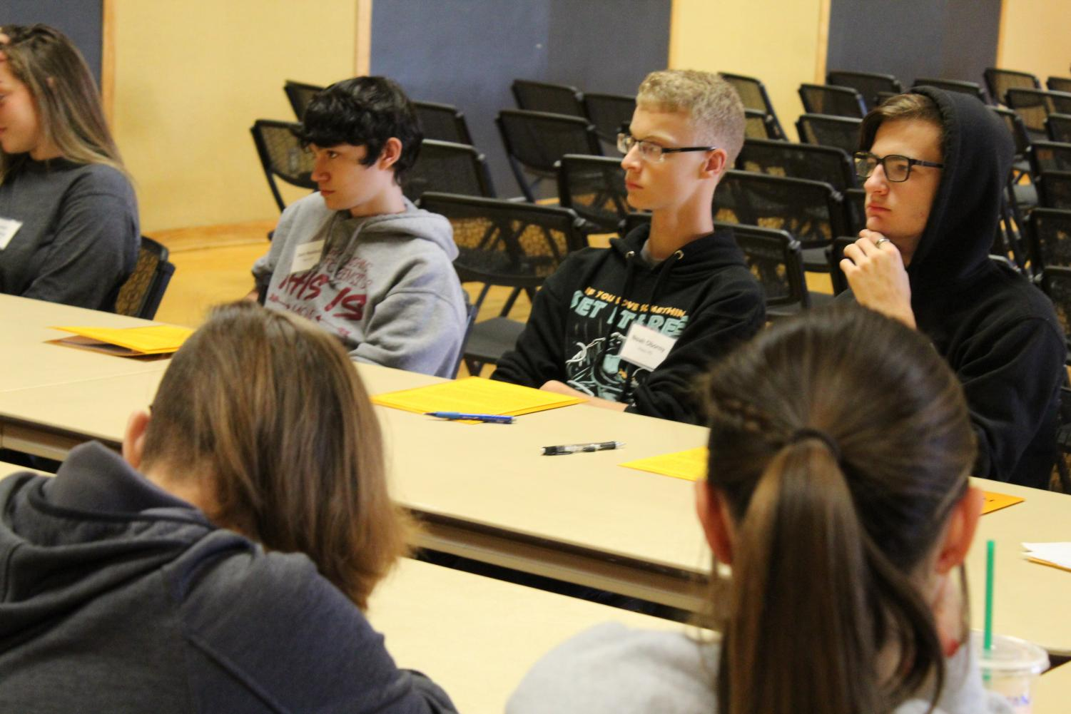 Seniors Jace Hesford, Noah Oborny, Elliot Hoar participate in a small group afternoon session for Philosophy Day. The event took place on Oct. 9 at Fort Hays State University in the Memorial Union.