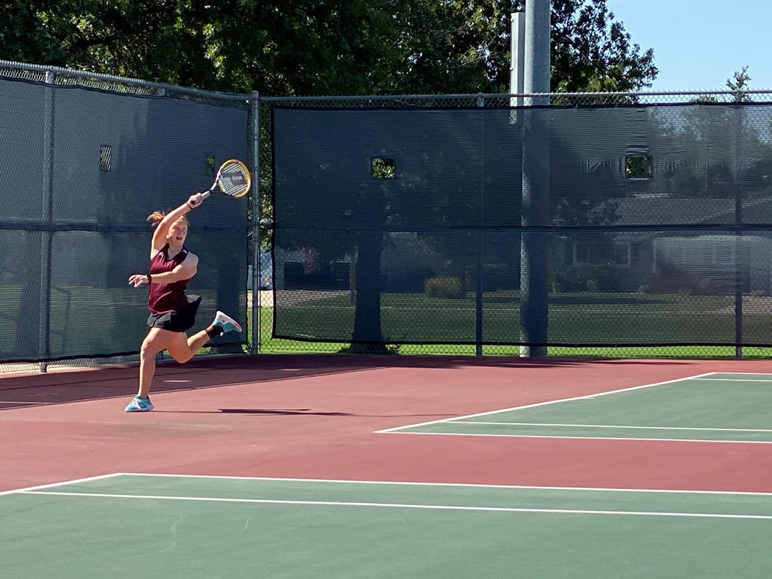 Senior Lynsie Hanson played #1 singles at the meet and placed 8th.