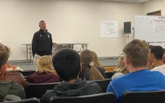 Eagle Radio sports director speaks to students on Oct. 30