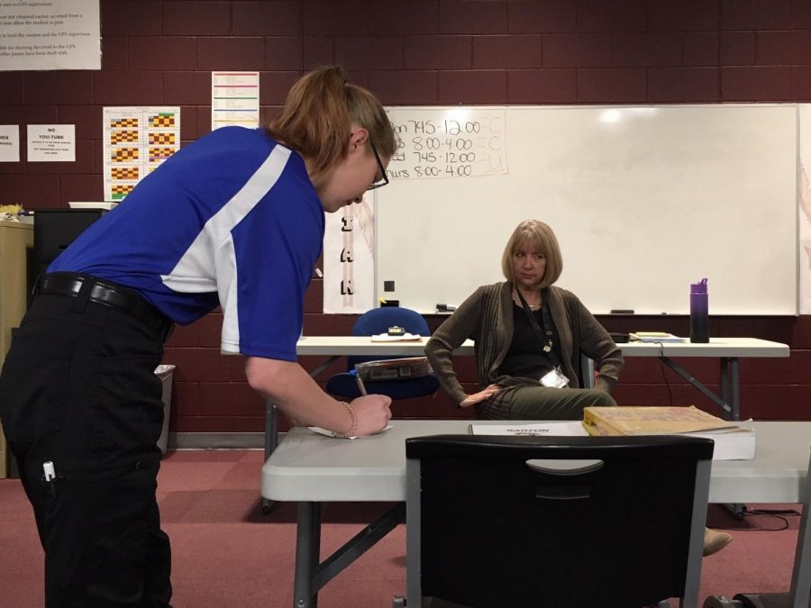 EMT in training Paige Zamecnik (left) performs a fake patient assessment on Instructor Lynn Zimmerman (right). Zamecnik wrote down symptoms Zimmerman reported before going into the medical assessment. Zamecnik along with Advanced EMT Scott Lisman presented to students during PRIDE Time on Oct. 30.